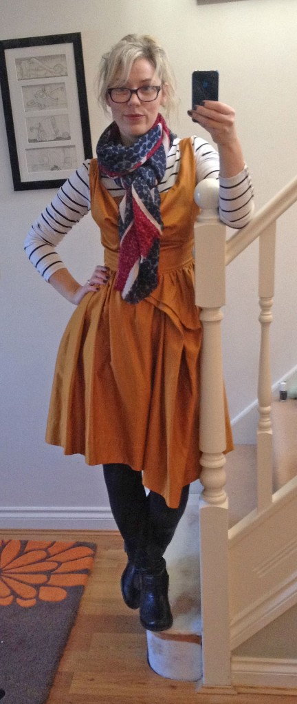 Dress - Vivienne Westwood;  Tee - H&M;  Scarf - Boden;  Boots - Faith